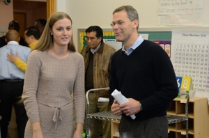 Teacher Amy Woolridge talks with Tom Boasberg, superintendent of Denver Public Schools, after wrapping up her classroom breakfast