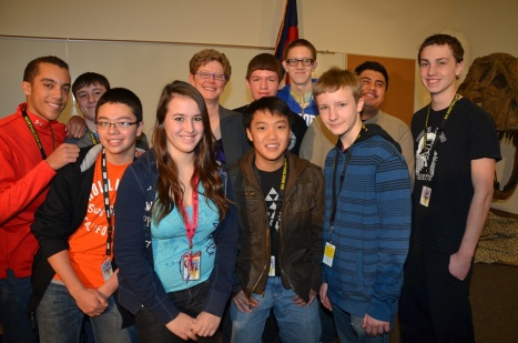 Kerrie Dallman with Northglenn High students after the press conference