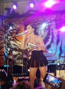 Katy Perry, in Lakewood cheerleader attire, sings for Lakewood High students in a private performance, Oct. 25.
