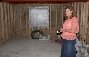 Jessicca in her ruined basement - the water crashed through the window.