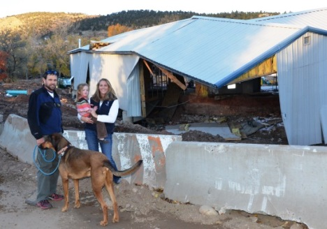 The Stahl family is back in Lyons, taking a walk among damaged roads and structures.