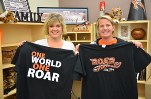"Lakewood teachers Tami LoSasso and Laura Zlogar show off the school's ""One World, One Roar"" t-shirts."