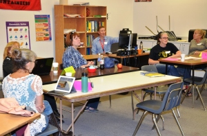 Catherine Gardner (second from right) takes in ideas to bring technology into her classroom