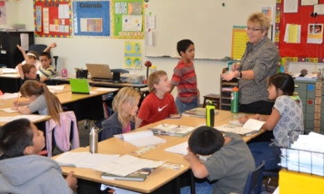 Yuma EA's Becky Lubbers guides her fourth-graders through a writing assignment at Morrison Elementary.