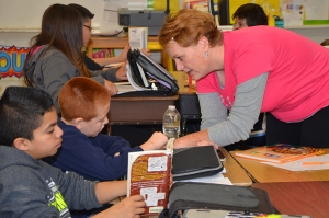 Kendra Zerfas checks progress one-on-one with her 5th graders