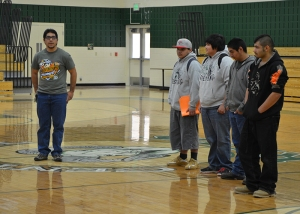 Apodaca congratulates his wrestling team at a school assembly