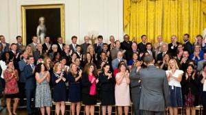 Oseth joins other honored teachers applauding President Obama's remarks at the White House, July 31.