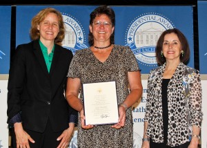 Kirstin receives her award from Megan Smith, U.S. Chief Technology Officer, and Dr. France Cordova, director, National Science Foundation.